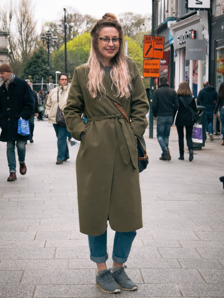 Girl in Dublin with bun and glasses