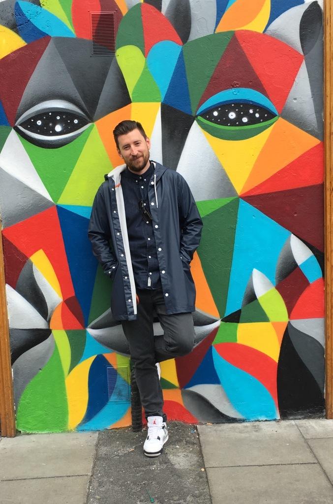 Man against a graffiti wall