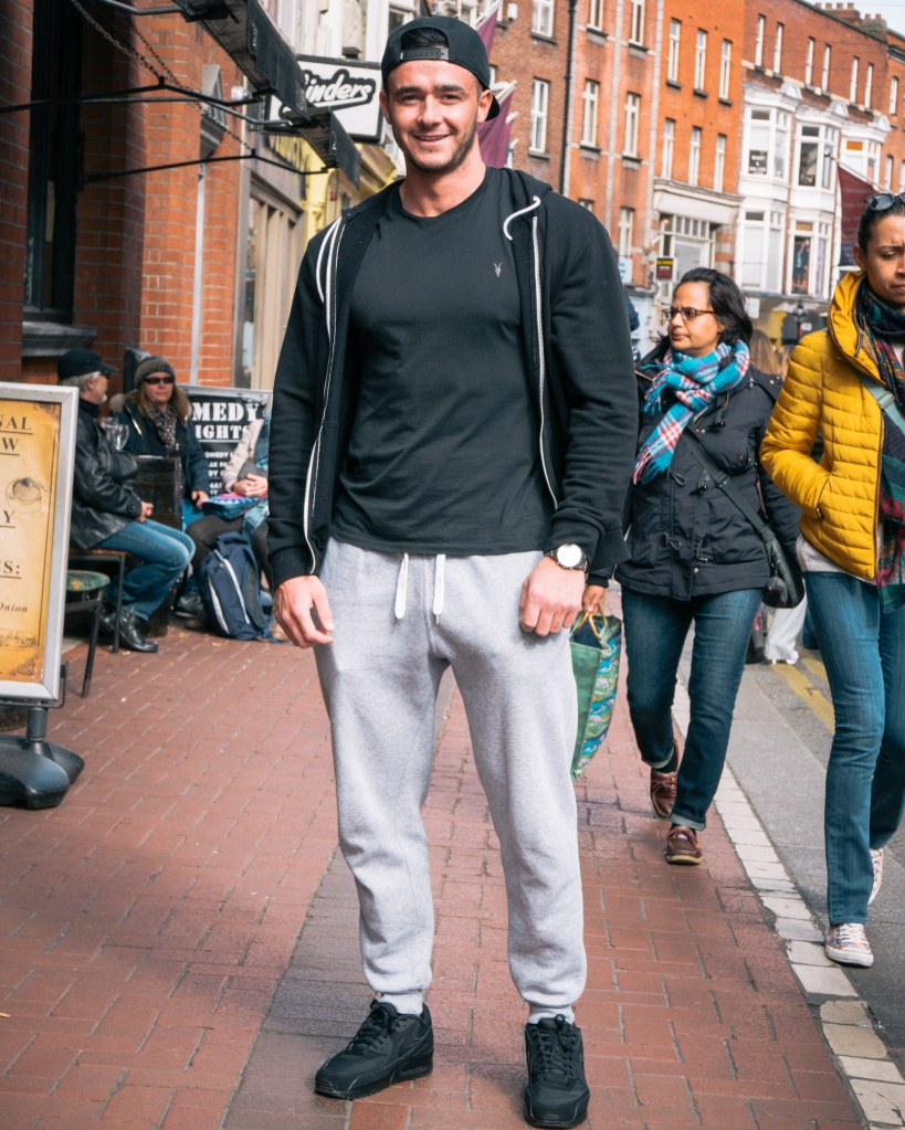 Man in Dublin grey tracksuit in airmax