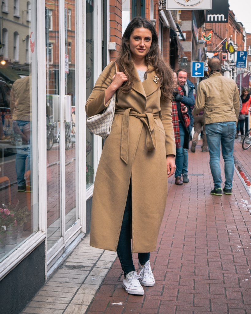 Girl in camel coat in Dublin city