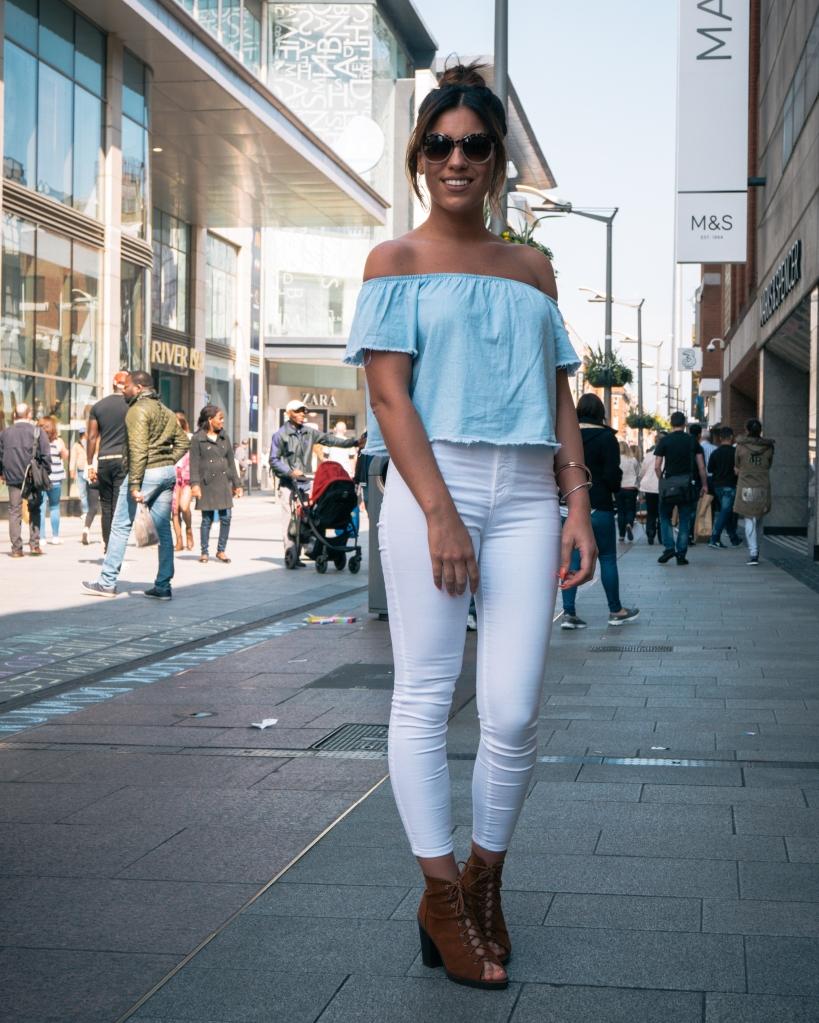 Girl in blue off the shoulder top Henry St