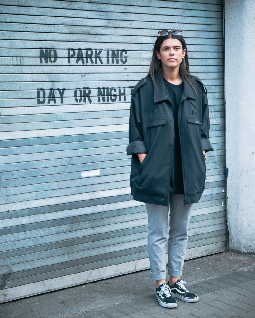 Girl in Dublin beside no parking sign