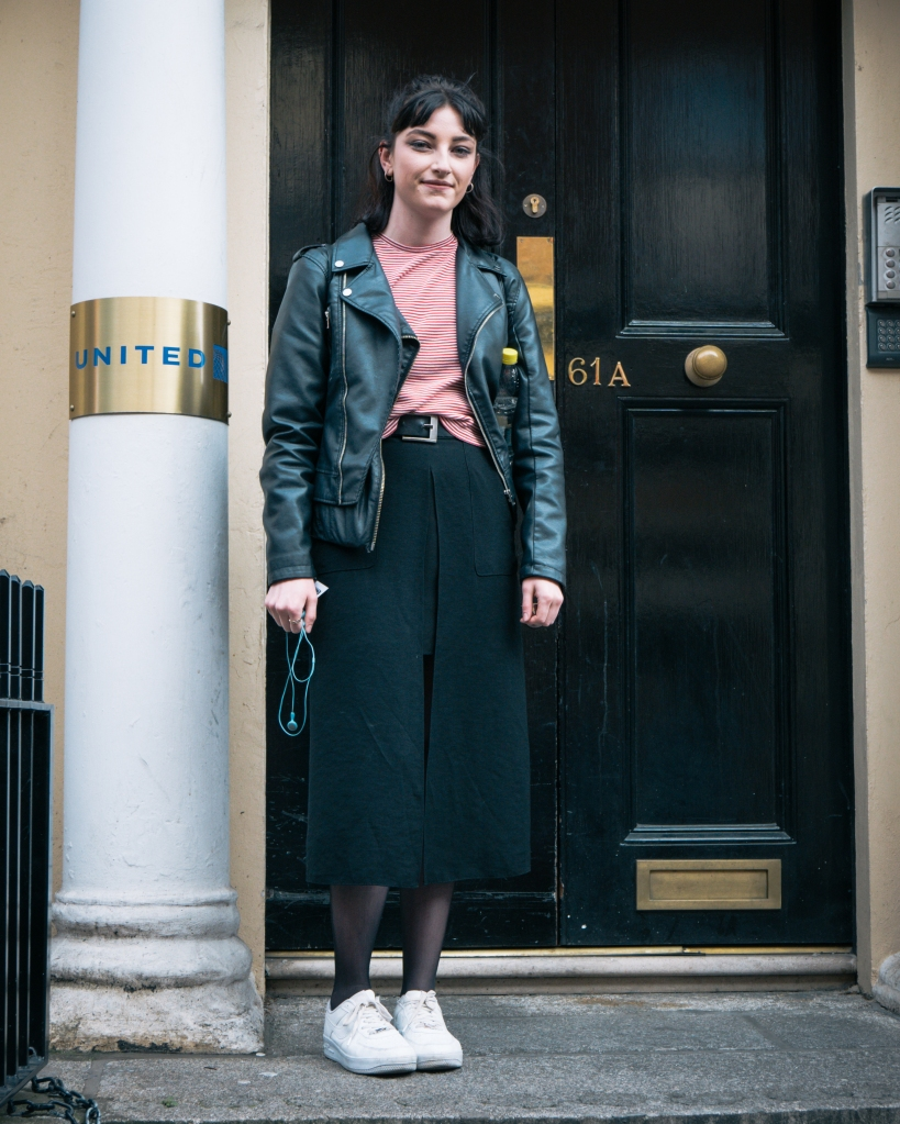 Woman on steps in culottes in Dublin