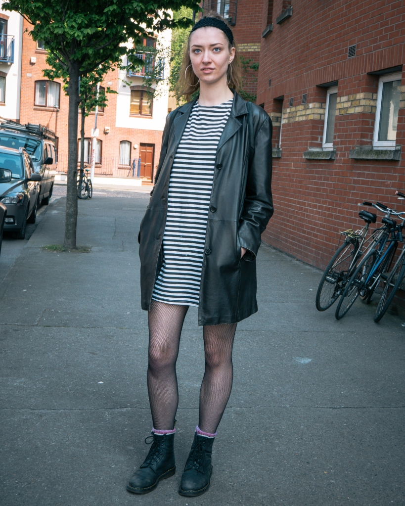 Girl in stripe dress and boots in Dublin