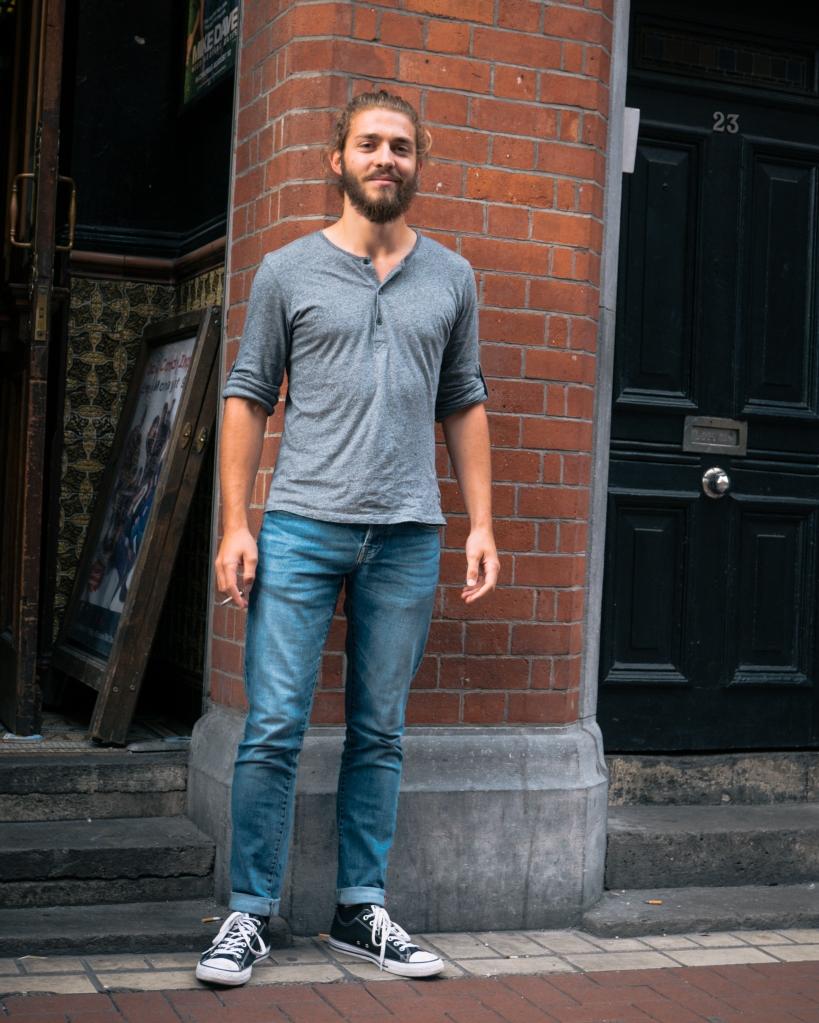 Man on step on Dublin pub