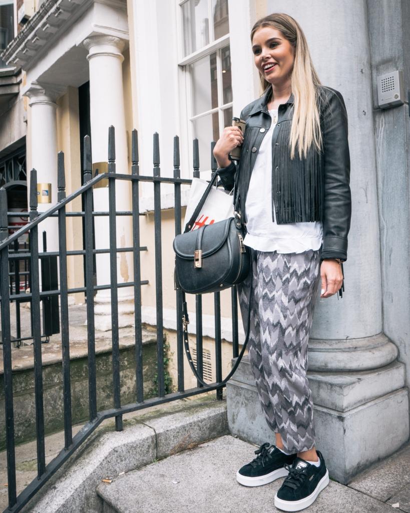 Blonde girl on steps in Dublin